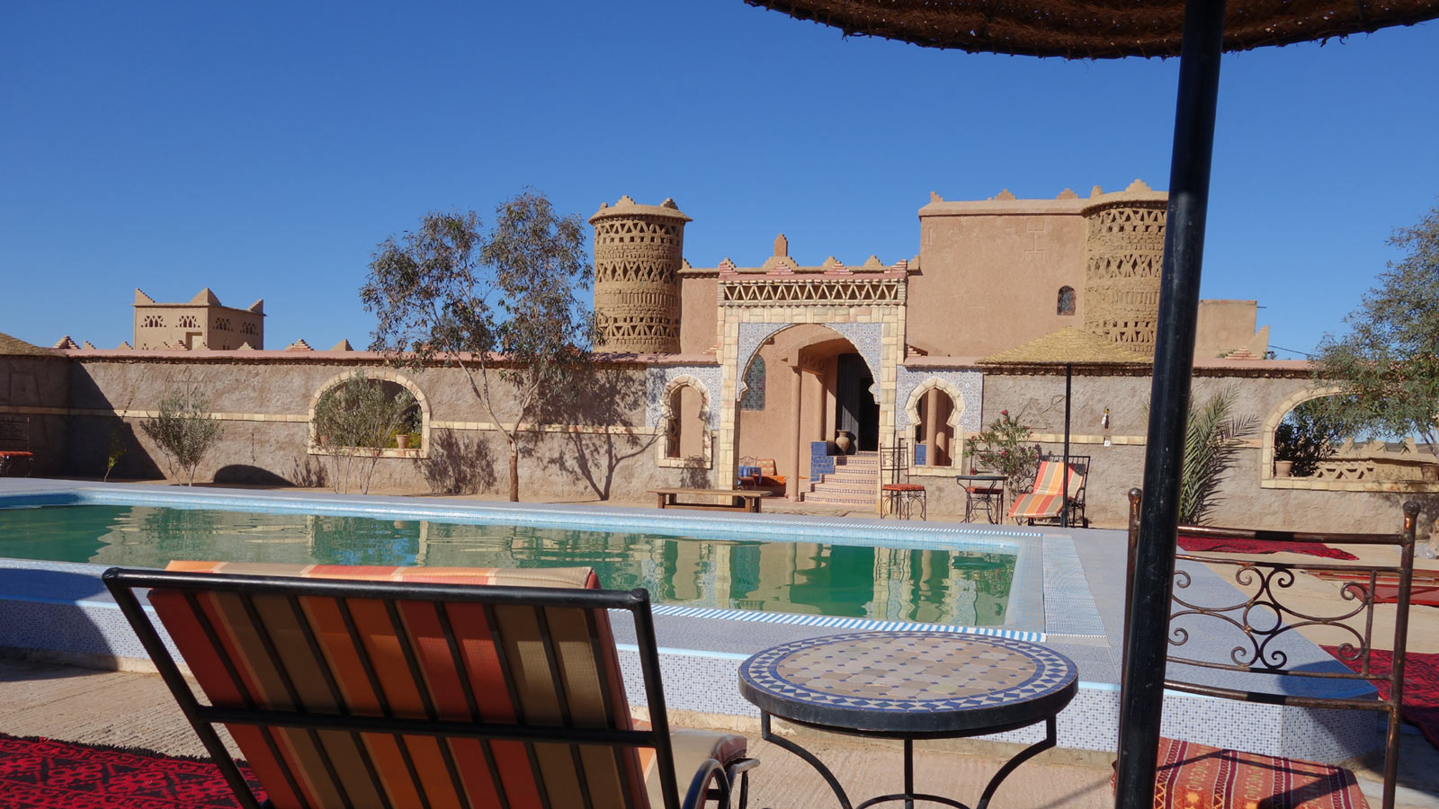Explore the House of the Sun, Swimming Pool hotel merzoug